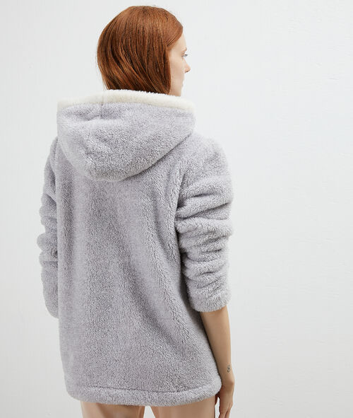 Fluffy jacket with animal pocket