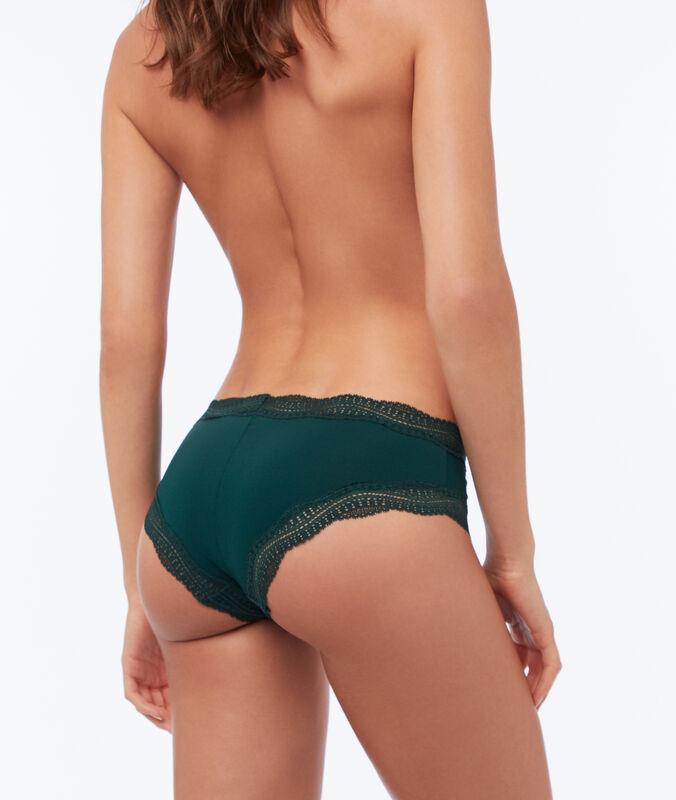 Ornate lace-edged shorts fir green.