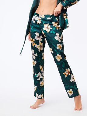Pantalon large imprimé floral vert.