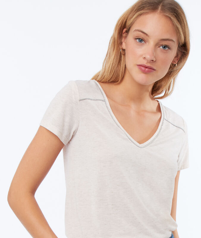 T-shirt à liseré métallisé nude.