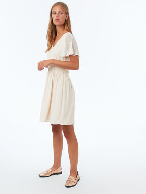 Dress with guipure sleeves nude.