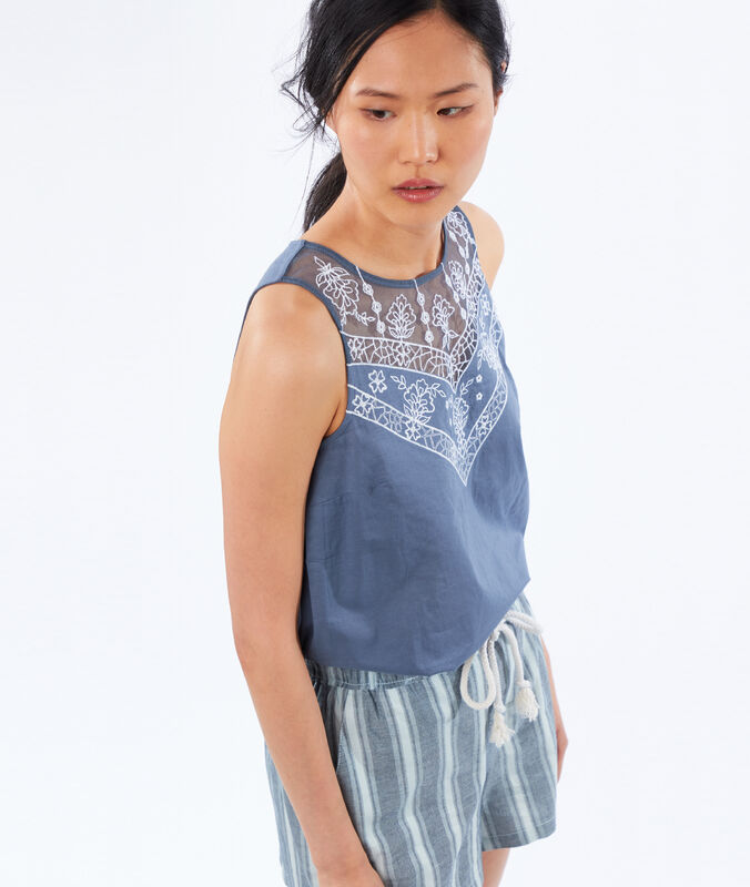 Embroidered neck sleeveless top slate grey.